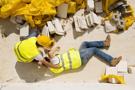 Foto de Construction worker has an accident while working on new house - Imagen libre de derechos