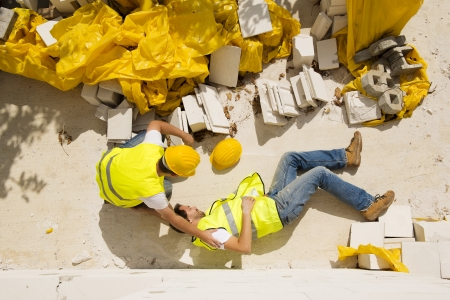 Photo for Construction worker has an accident while working on new house - Royalty Free Image