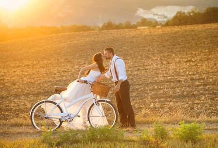 Photo for Beautiful bride and groom wedding portrait with white bike - Royalty Free Image