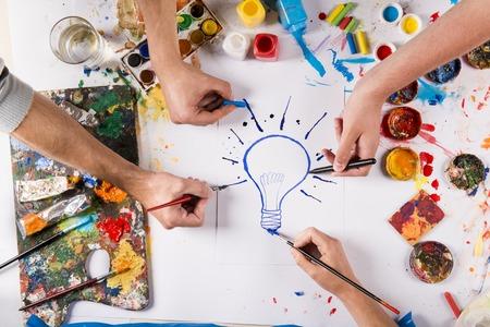 Foto de Creative idea concept with colorful paints over white paper - Imagen libre de derechos