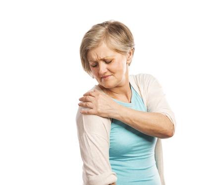 Photo pour Senior woman with shoulder pain, isolated on white background - image libre de droit