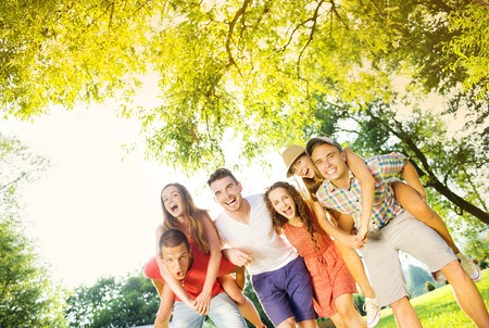 Photo for Group of five teenage friends having fun in park - Royalty Free Image
