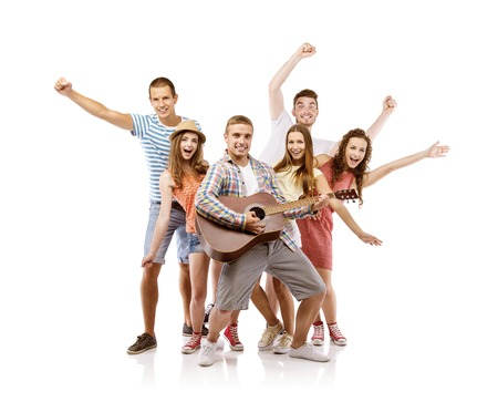 Photo for Group of happy young people having fun with guitar, isolated on white background  Best friends - Royalty Free Image
