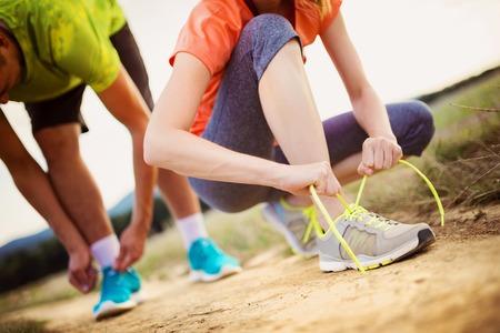 Foto per Runner feet. Running couple closeup of running shoes. - Immagine Royalty Free
