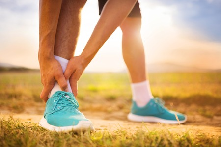 Photo pour Runner leg and muscle pain during running training outdoors in summer nature - image libre de droit