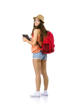 Photo pour Young female tourist using digital tablet, isolated on white background - image libre de droit