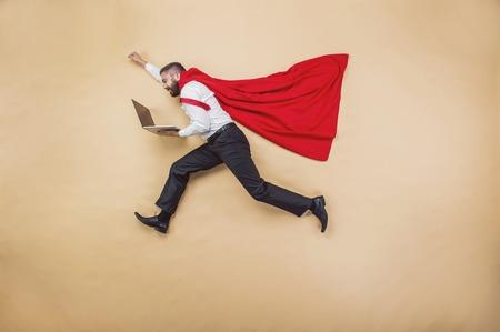 Photo pour Manager with coat. Superhero in studio. - image libre de droit