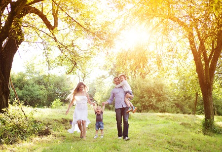 Photo pour Happy young family spending time together outside in green nature. - image libre de droit