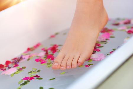 Foto de Beautiful young woman taking a herbal bath. - Imagen libre de derechos
