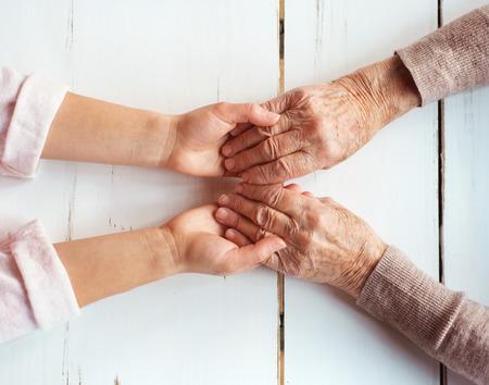 Foto de Unrecognizable grandmother and her granddaughter holding hands. - Imagen libre de derechos