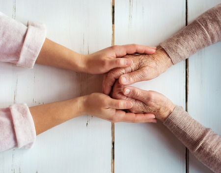 Photo pour Unrecognizable grandmother and her granddaughter holding hands. - image libre de droit