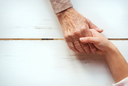 Photo for Unrecognizable grandmother and her granddaughter holding hands. - Royalty Free Image