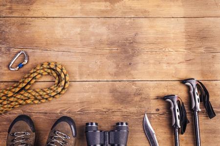 Foto de Equipment for hiking on a wooden floor background - Imagen libre de derechos