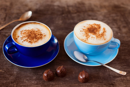 Foto de Two cups of coffee on a wooden table background - Imagen libre de derechos