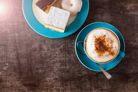 Photo for Coffee and cakes on a wooden table  - Royalty Free Image