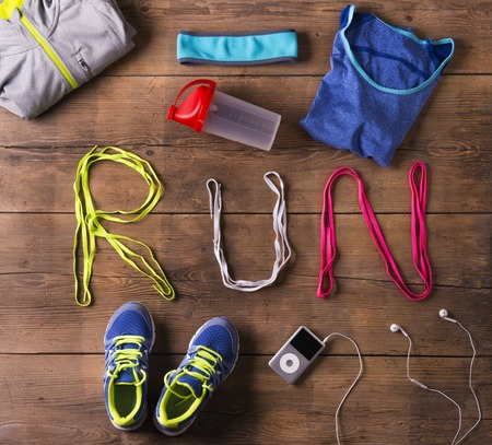 Photo pour Shoelaces run sign and various running stuff on a wooden floor background - image libre de droit