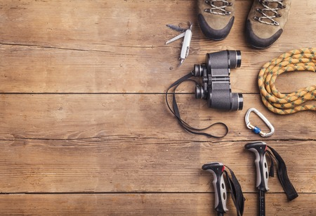 Foto de Equipment for hiking on a wooden floor background - Imagen libre de derechos