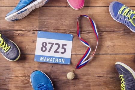 Photo pour Various running shoes laid on a wooden floor background - image libre de droit