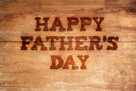 Photo for Happy fathers day sign on wooden boards background. - Royalty Free Image
