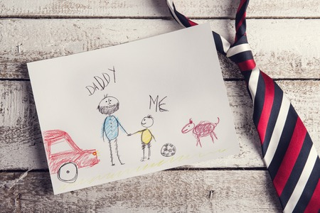 Photo pour Fathers day composition with child\'s drawing and colorful tie laid on wooden desk background. - image libre de droit
