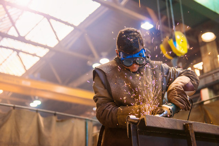 Photo for Young man with protective goggles welding in a factory - Royalty Free Image