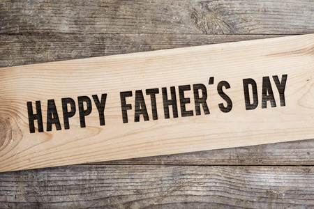 Foto de Happy fathers day sign on wooden boards background. - Imagen libre de derechos