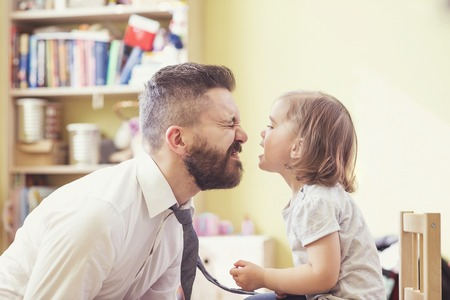 Photo for Young hipster father with his beautiful little daughter - Royalty Free Image