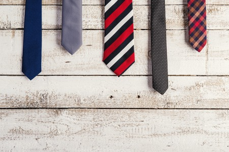 Foto de Fathers day composition of various ties hang on wooden wall background. - Imagen libre de derechos