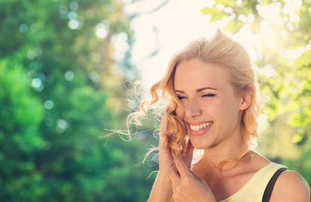 Photo for Attractive young woman outside in summer nature - Royalty Free Image