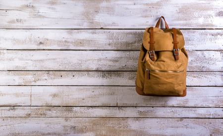 Photo pour Desk with school supplies. Studio shot on wooden background. - image libre de droit