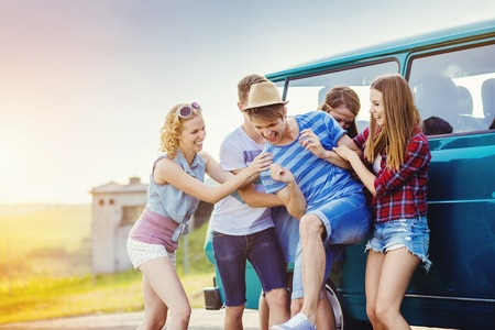 Photo for Young hipster friends on road trip on a summer day - Royalty Free Image