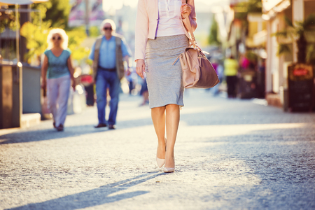 Photo for Attractive young business woman walking in the city - Royalty Free Image