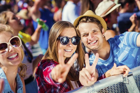 Photo for Group of beautiful teens at concert at summer festival - Royalty Free Image