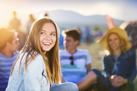 Photo for Group of beautiful teens camping at summer festival - Royalty Free Image