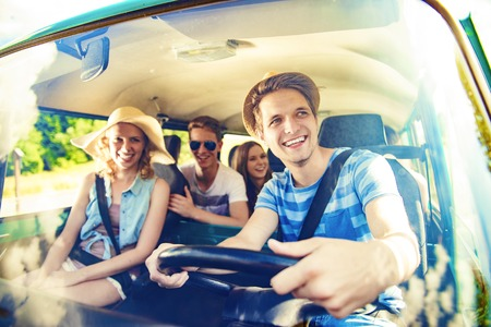 Foto de Beautiful young people on a road trip on a summers day - Imagen libre de derechos