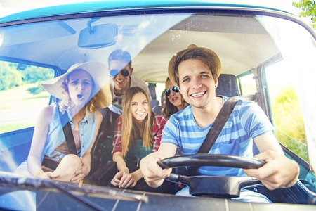 Photo for Beautiful young people on a road trip on a summers day - Royalty Free Image