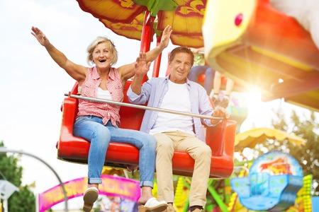 Photo for Senior couple having fun in amusement park - Royalty Free Image