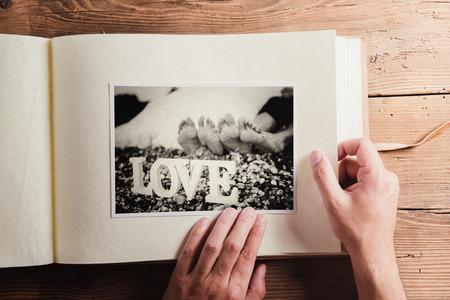 Photo pour Black and white picture in photo album. Studio shot on wooden background. - image libre de droit