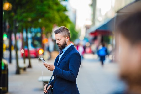 Foto per Handsome young manager with smartphone in London - Immagine Royalty Free