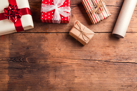 Photo pour Christmas presents laid on a wooden table background - image libre de droit