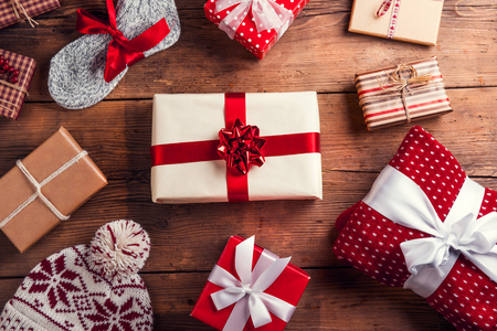 Photo for Christmas presents laid on a wooden table background - Royalty Free Image