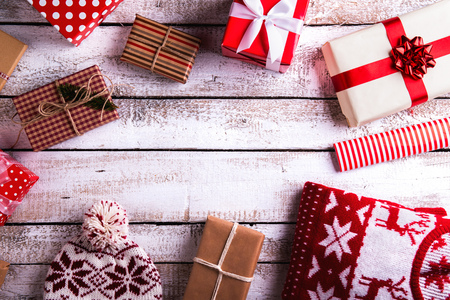 Photo for Christmas presents laid on a white wooden table background - Royalty Free Image