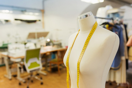 Photo for Tailors white textile dummy with yellow measure tape - Royalty Free Image