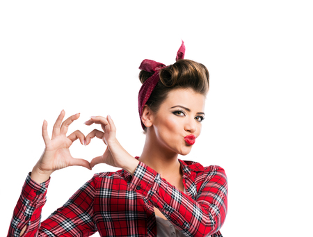 Photo pour Beautiful young woman with pin-up make-up and hairstyle. Studio shot on white background - image libre de droit