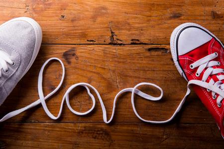Foto de Love composition. Studio shot on wooden background. - Imagen libre de derechos