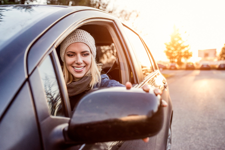 Photo for Beautiful young blond woman driving a car - Royalty Free Image