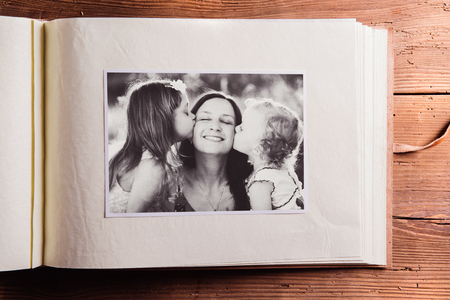 Photo for Mothers day composition. Photo album, black-and-white picture. Studio shot on wooden background. - Royalty Free Image