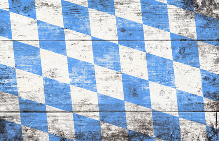 Foto de Oktoberfest background with blue and white rhombus pattern. Wooden background. Studio shot. - Imagen libre de derechos