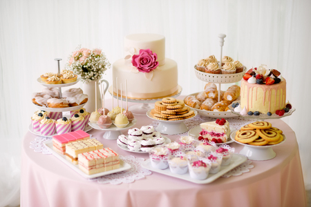 Photo for Table with loads of cakes, cupcakes, cookies and cakepops. Studio shot. - Royalty Free Image