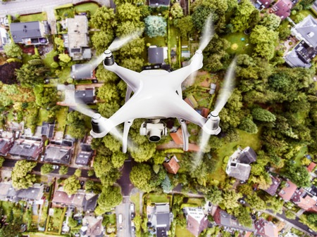Photo for Hovering drone taking pictures of Dutch town, houses with gardens, green park with trees. Aerial view. - Royalty Free Image